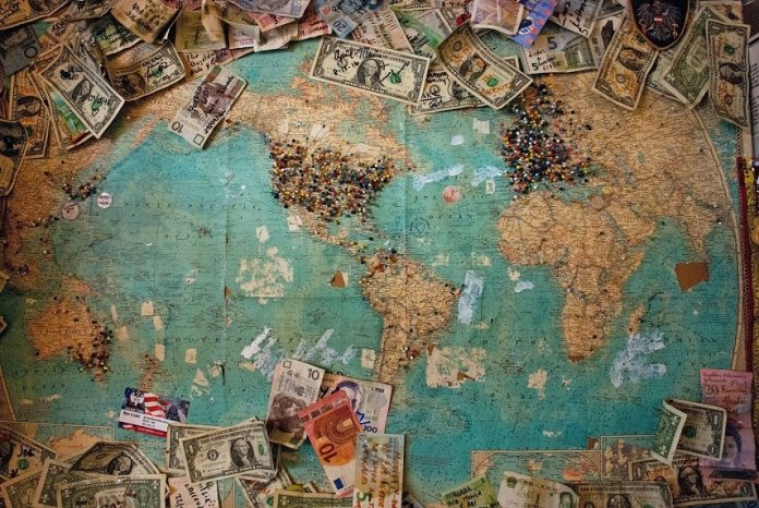 Central Bank Balance Sheet, different bills pinned to a world map