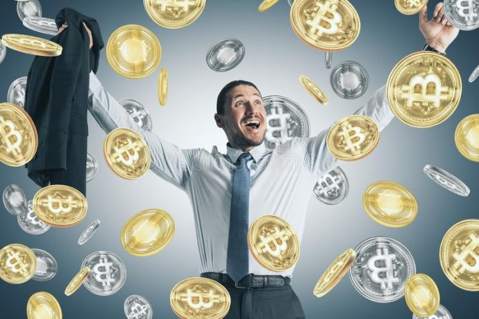 Picture of a businessman smiling as it rains bitcoins