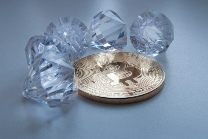Picture of a bitcoin with five diamonds around it